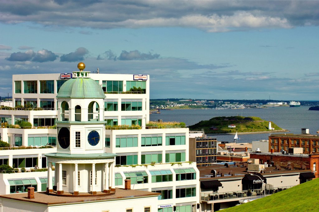Stock Photo: 1990-50646 The Citadel fort clock tower in the foreground with Halifax Harbour in background, Nova Scotia, Canada