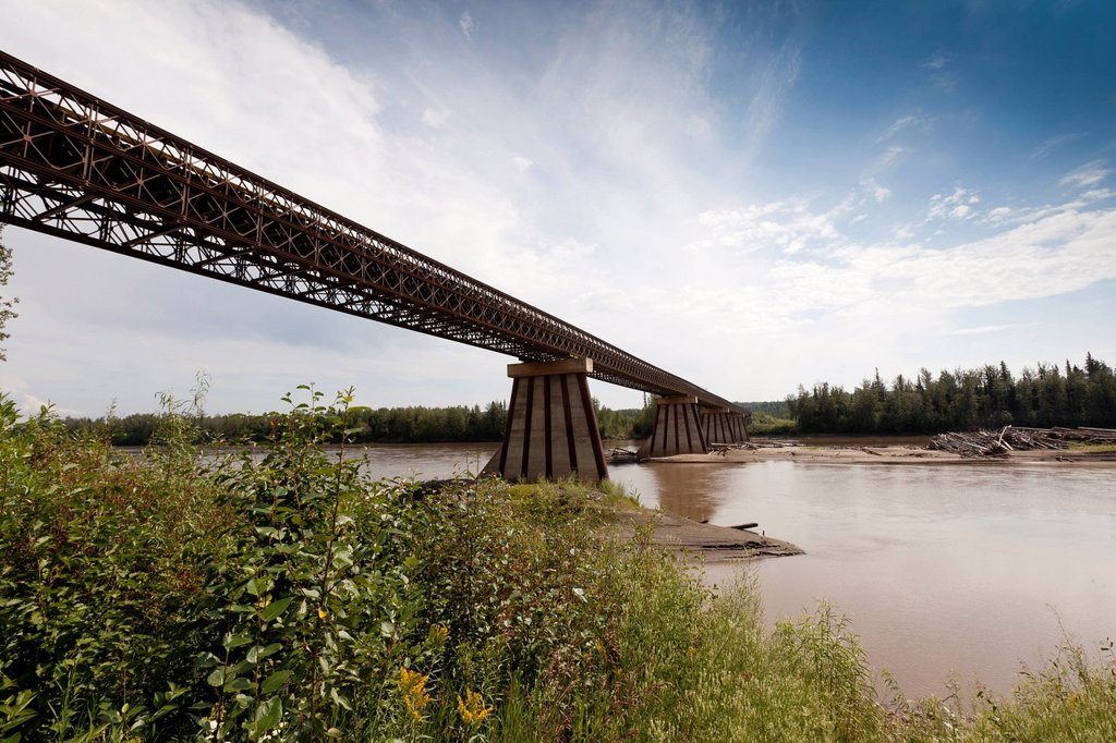 Fort Nelson River Bridge is a 1_lane wood_decked bridge crossing the Fort Nelson River on the Highway 77 portion of the Liard Trail in British Columbia, Canada : Stock Photo