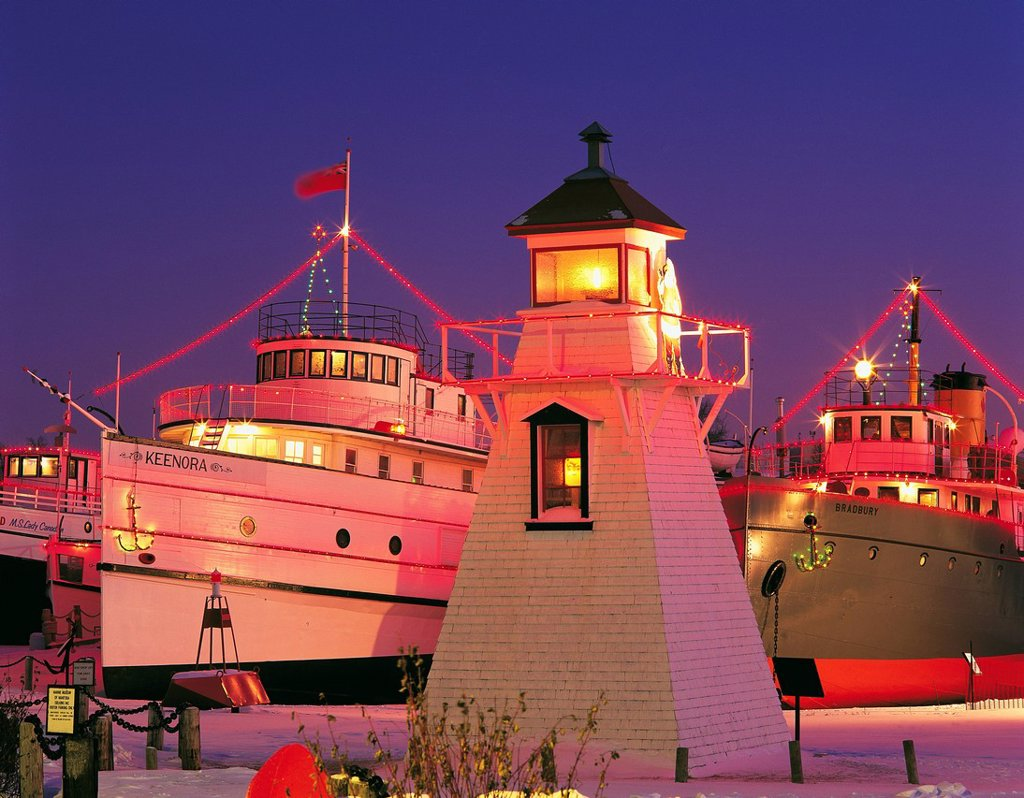 Stock Photo: 1990-52564 Christmas lights on ships and lighthouse, Marine Museum of Manitoba, Selkirk, Manitoba, Canada