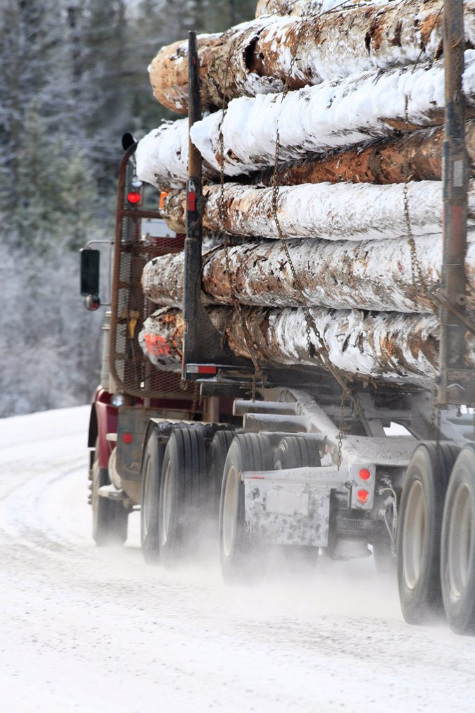 Loaded logging truck in winter, Smithers, British Columbia, Canada. : Stock Photo
