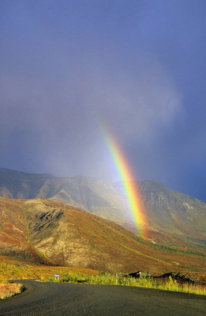 Rainbow over the Dempster Highway in the Tombstone Mountains, Yukon Territory, Canada. : Stock Photo