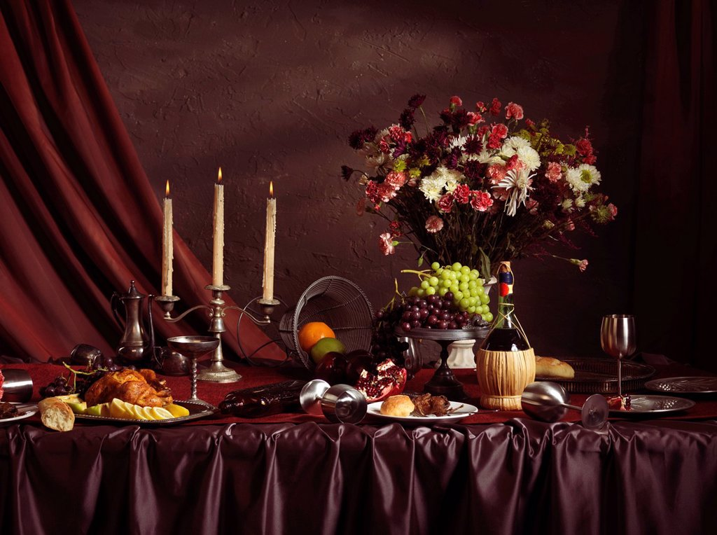 Stock Photo: 1990-53823 Artistic food still life of remains of a festive dinner on a table