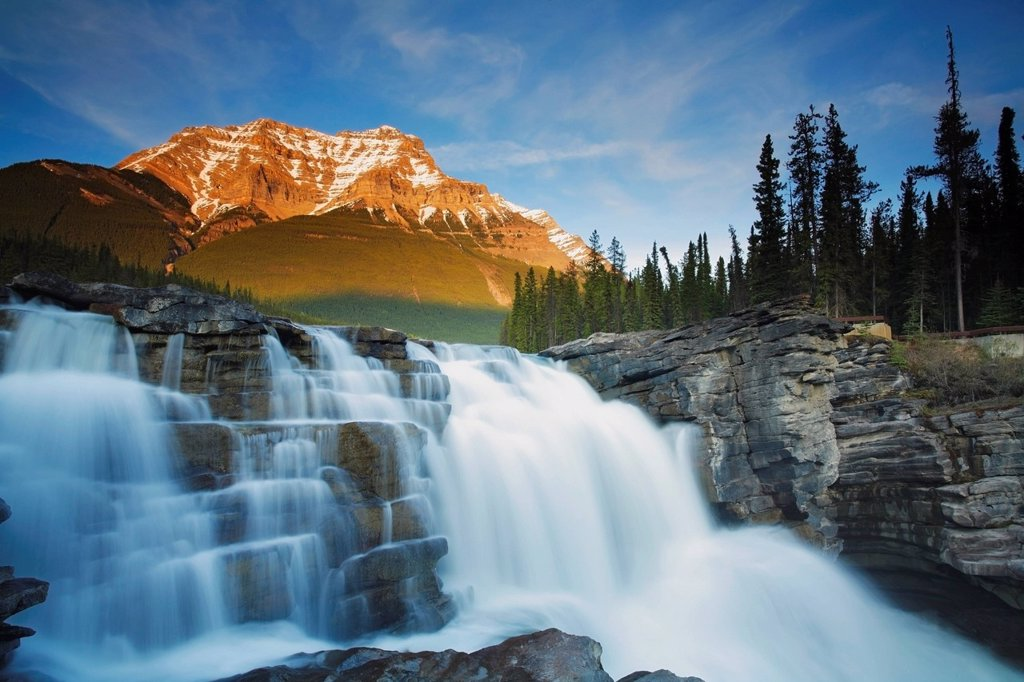 Athabasca Falls with Mount Kerkeslin in the background in early spring, Jasper National Park, Alberta, Canada : Stock Photo