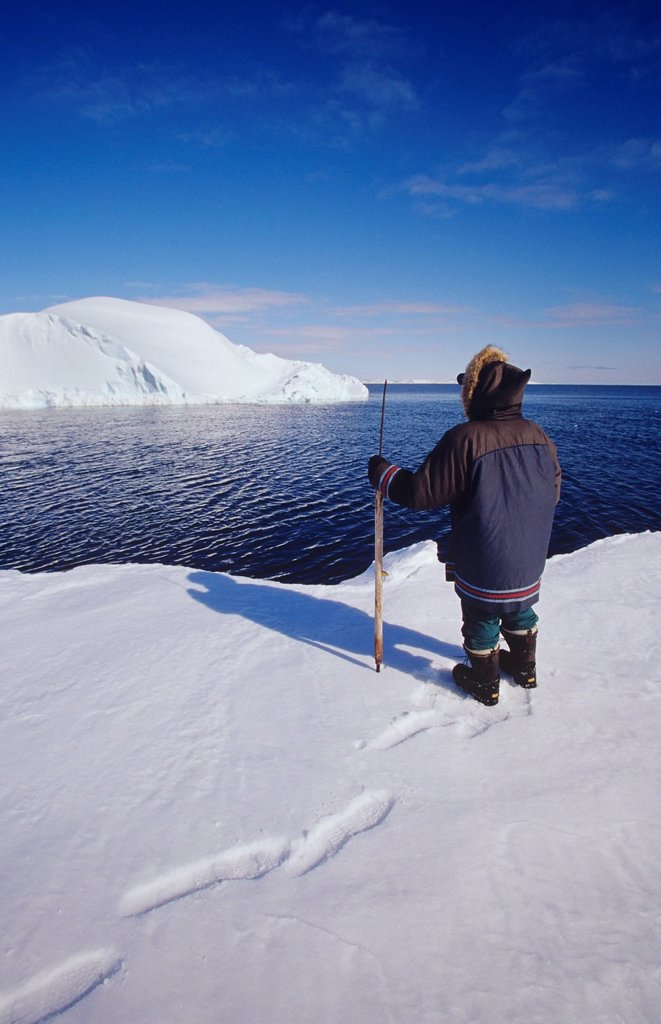 Inuit hunter at flow edge, Kimmirut, Baffin Island, Nunavut, Canada. : Stock Photo