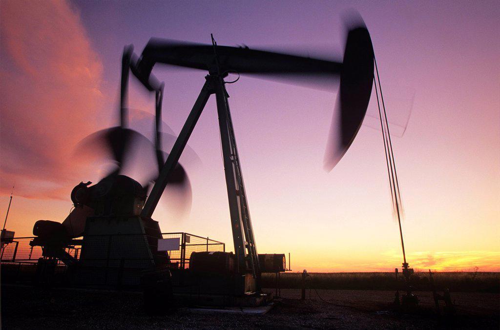 Stock Photo: 1990-54857 moving pumpjack near Carlyle, Saskatchewan, Canada.
