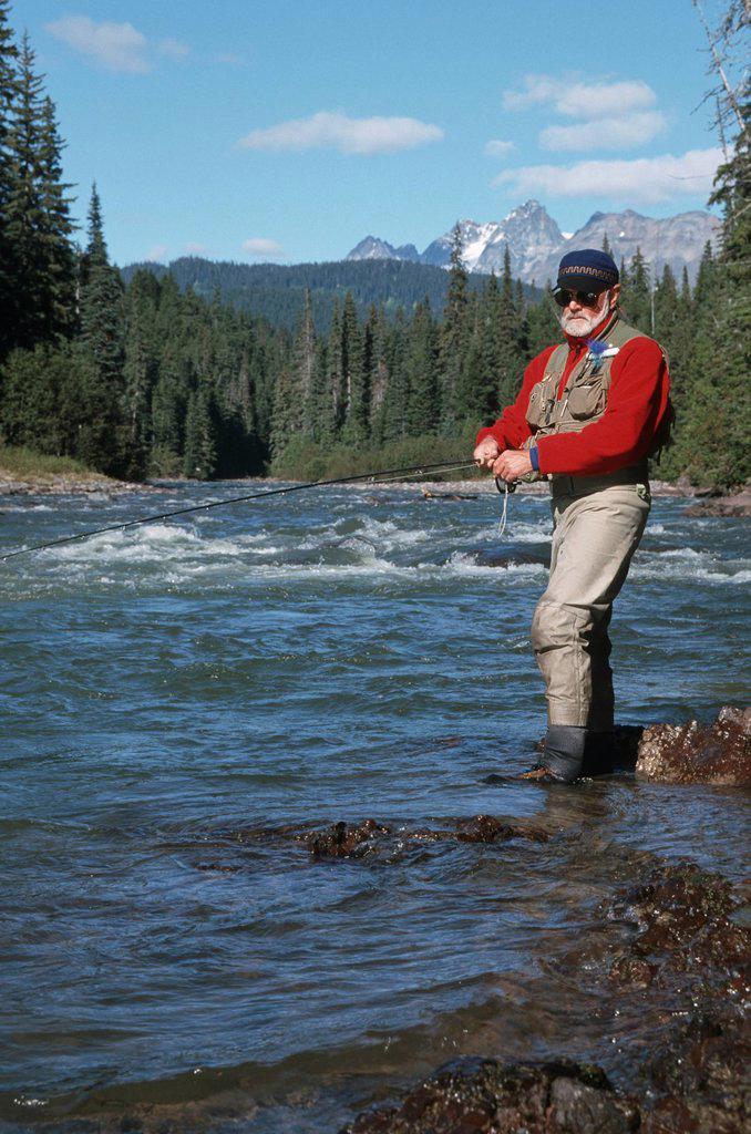 Stock Photo: 1990-55748 Flyfisherman fishing for steelhead on remote northern river, British Columbia, Canada.