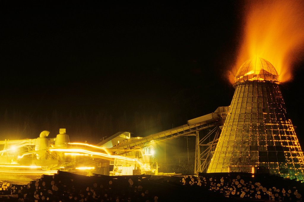 Stock Photo: 1990-55963 Sawmill with beehive burner at night, Smithers, British Columbia, Canada.