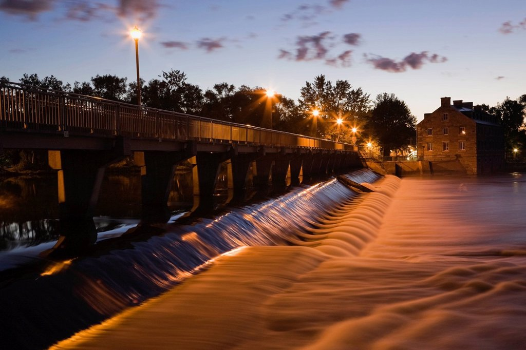 Stock Photo: 1990-57594 New Mill and water flow control dam on the Mille_Iles river illuminated at dawn, Ile des Moulins, Old Terrebonne, Lanaudiere, Quebec, Canada