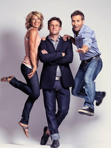 Artistic portrait of smiling casually but with style dressed two men and a woman wearing jeans : Stock Photo