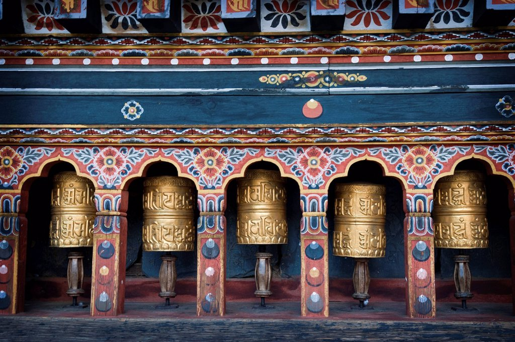 Stock Photo: 1990-58900 Prayer wheels at Trashichodzong Dzong, or the fortress of the glorious religion, which is the government and monastic headquarters in the capital city Thimphu, Bhutan.