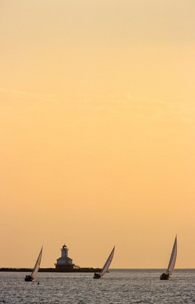 Sailboats racing off Schurman´s Point Lighthouse, Summerside, Prince Edward Island, Canada : Stock Photo