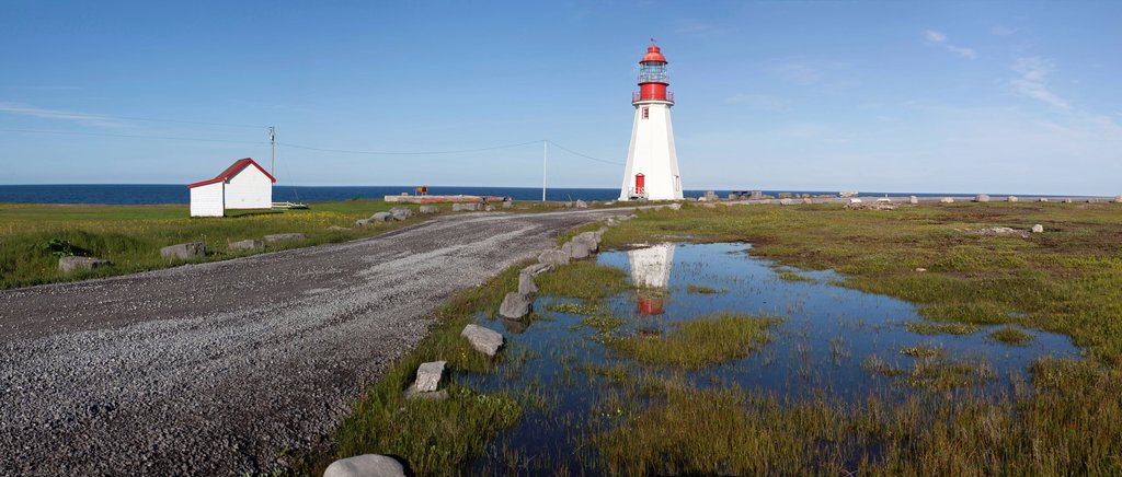 Digitally stitched panoramic image of the Point Riche Lighthouse, Port au Choix National Historic Site, on the Great Northern Peninsula on the island of Newfoundland, Newfoundland and Labrador, Canada : Stock Photo