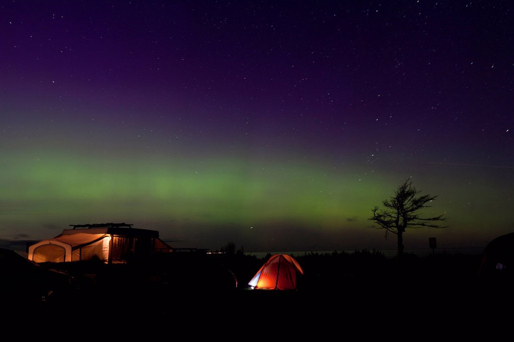 Stock Photo: 1990-60218 Northern Lights Aurora Borealis over beach side campsites in Prince Edward Island National Park on Prince Edward Island, PEI, Canada
