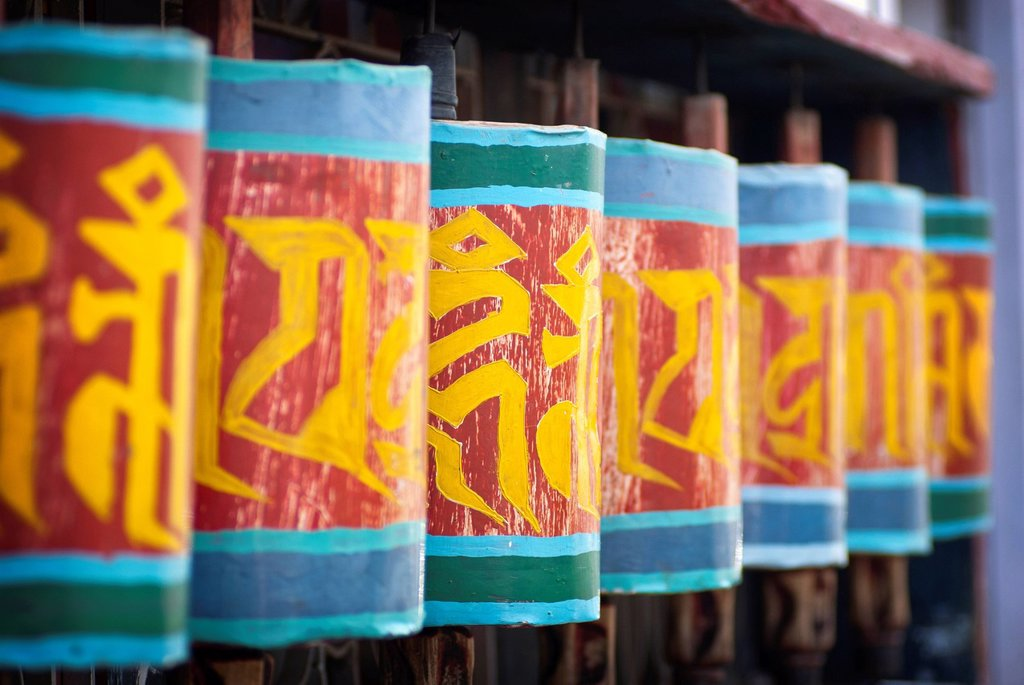 Stock Photo: 1990-60627 Prayer wheels along the streets of Paro, Bhutan.