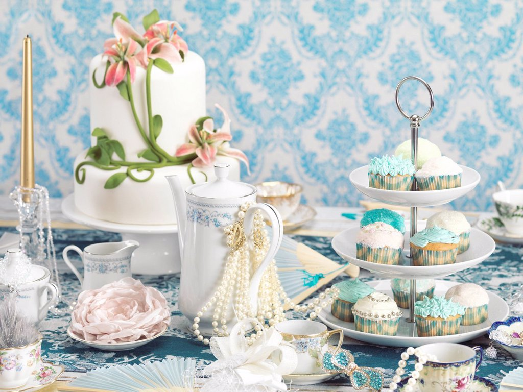 Stock Photo: 1990-61288 Luxurious tea party still life combining desserts and jewellery