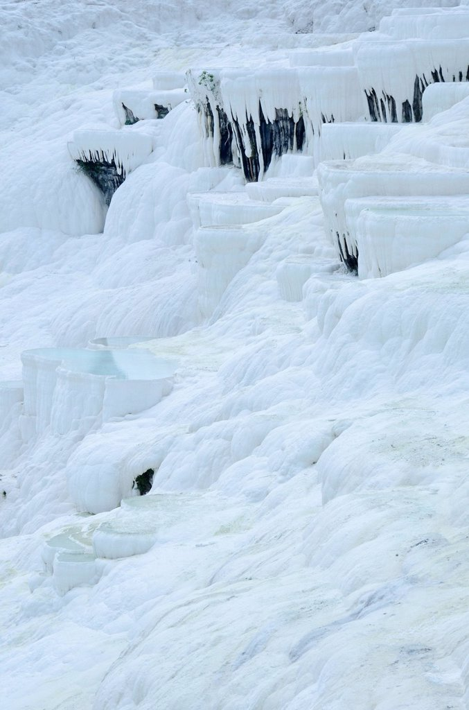 Pamukkale hot springs and travertines, terraces of carbonate minerals left by the flowing water in Denizli Province in southwestern Turkey : Stock Photo
