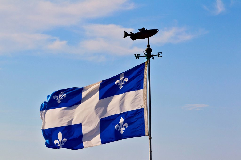 Salmon windvane and Quebec flag, Carleton_sur_Mer, Gaspe, Quebec, Canada : Stock Photo