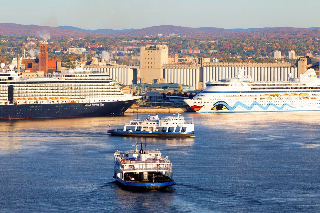 Car ferries crossing the St. Lawrence River in front of cruise ship docked at Quebec City, Quebec, Canada : Stock Photo