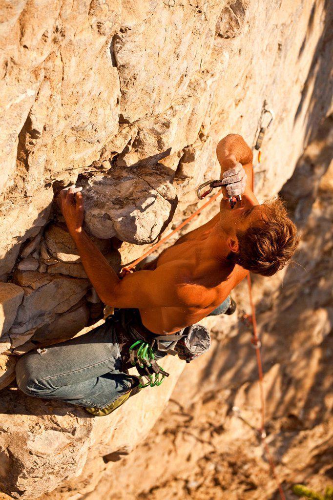 Stock Photo: 1990-62929 A man rock climbs the sport route Peyto Powder 12a, Echo Canyon, Canmore, Alberta, Canada