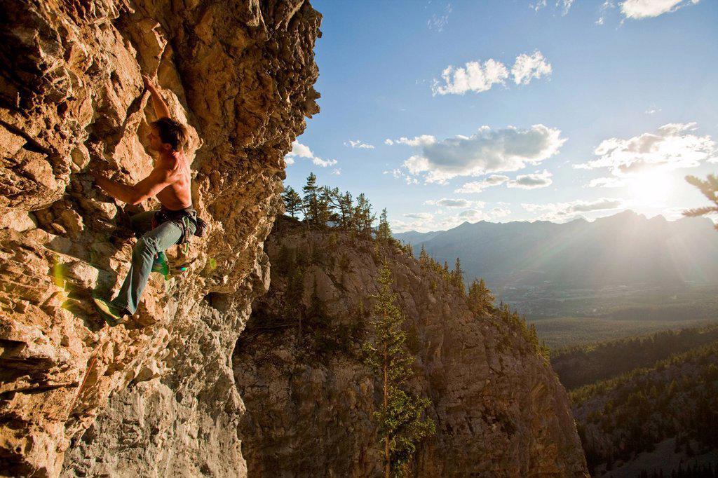 A man rock climbs the sport route Peyto Powder 12a, Echo Canyon, Canmore, Alberta, Canada : Stock Photo