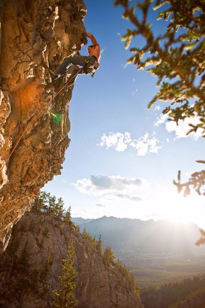Stock Photo: 1990-62932 A man rock climbs the sport route Peyto Powder 12a, Echo Canyon, Canmore, Alberta, Canada