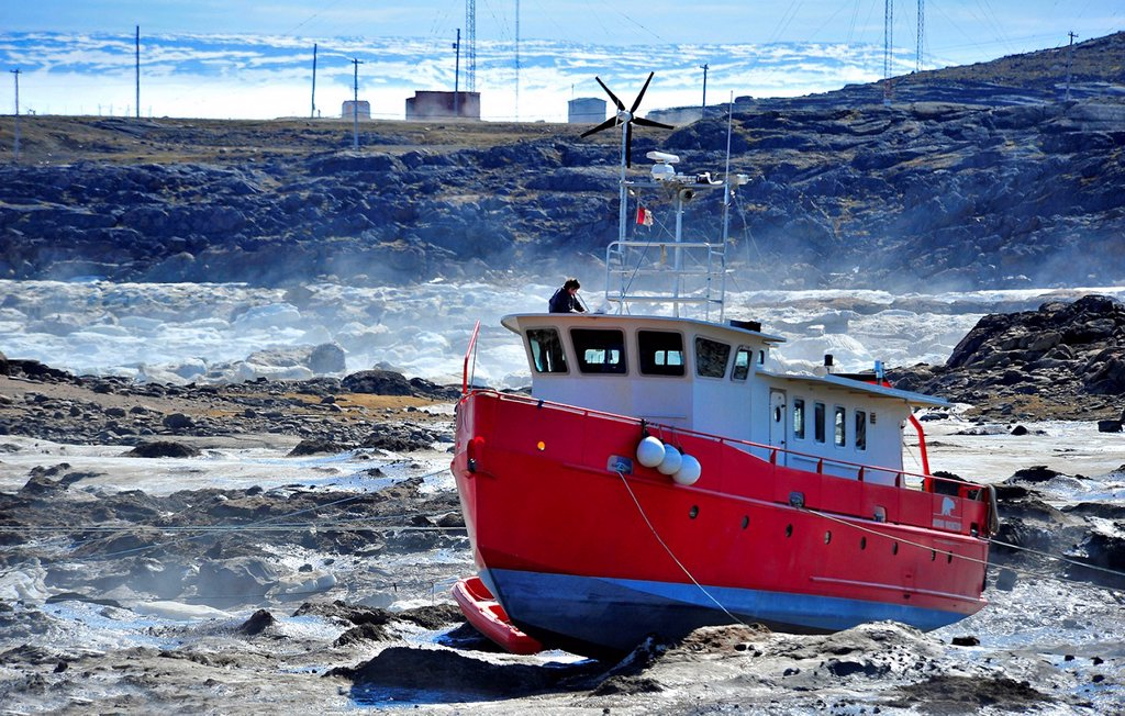 Stock Photo: 1990-63379 Boat Beached at low tide Iqaluit, Nunavut, Canada