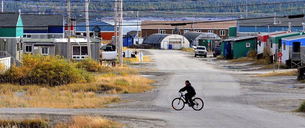 Stock Photo: 1990-63476 Inuit boy biking in Kuujjuaq, Nunavik, Canada
