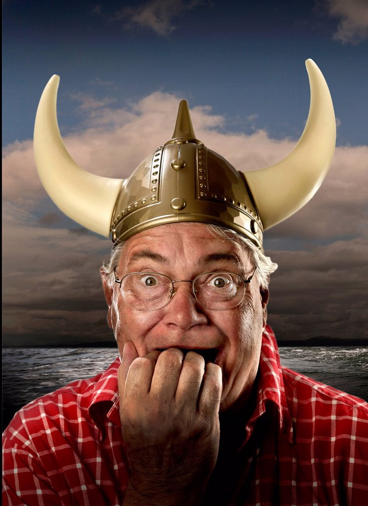 MAN WITH VIKING HELMET AFRAID,MODEL RELEASE : Stock Photo