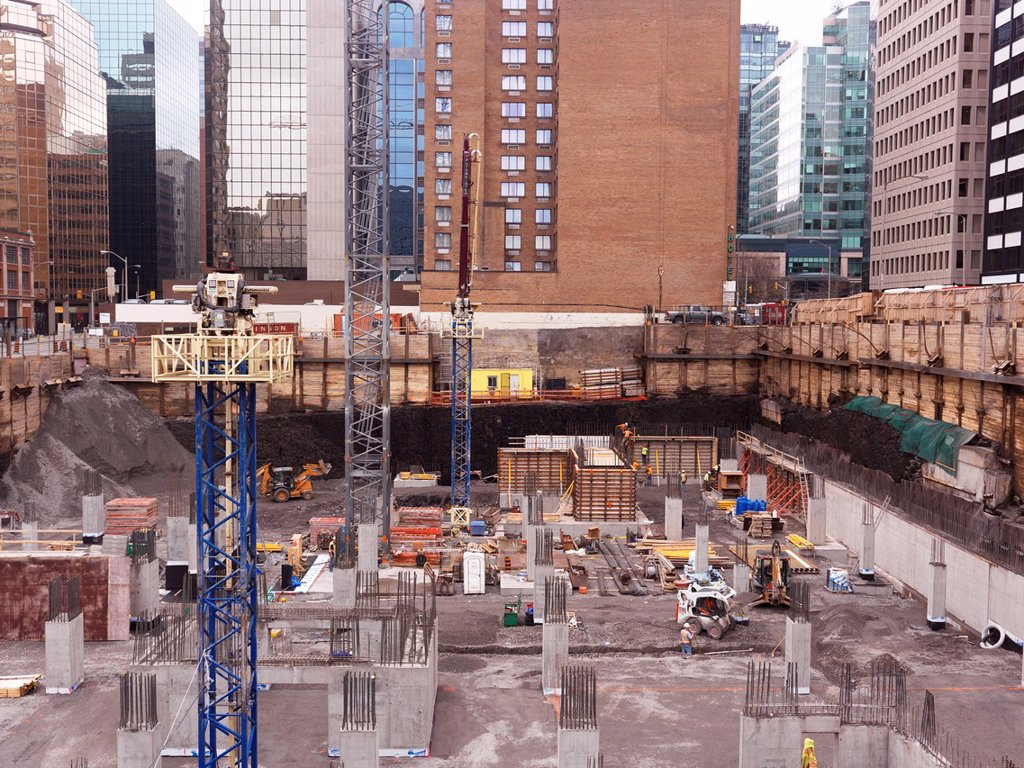 Stock Photo: 1990-64322 People working at a construction site, building foundation pit. Ottawa, Ontario, Canada.