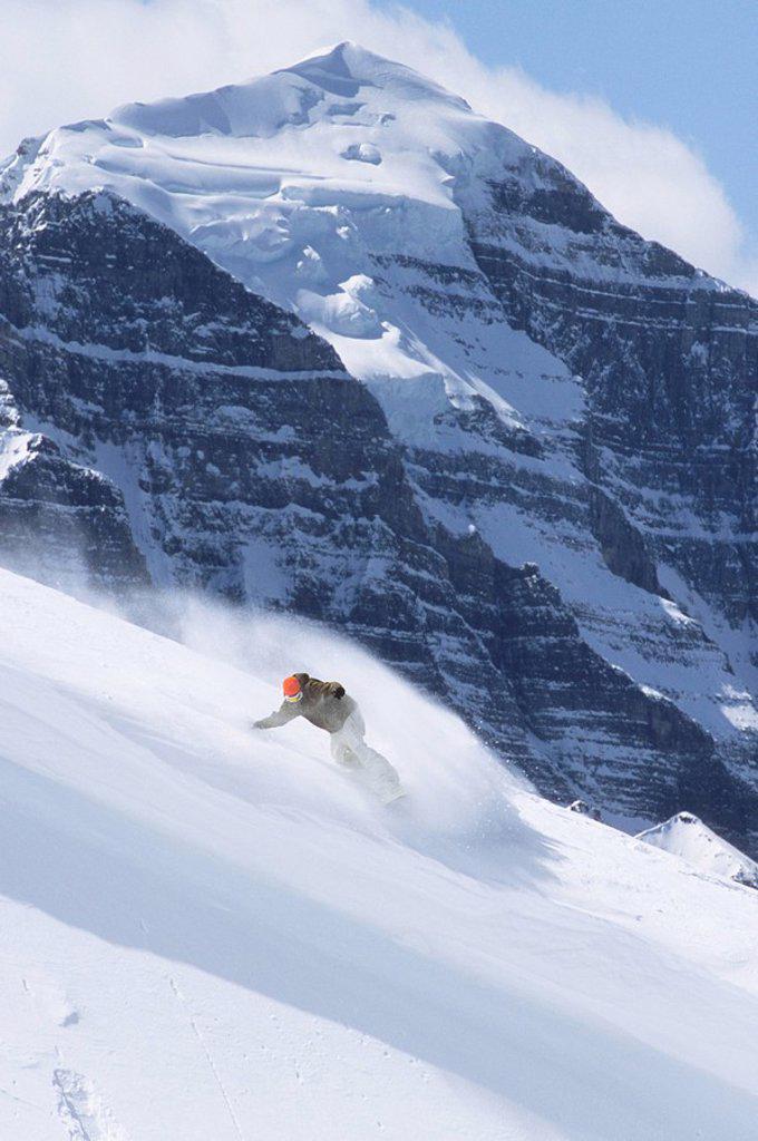 Stock Photo: 1990-6433 young man backcountry snowboarding at Lake Louise, Alberta, Canada