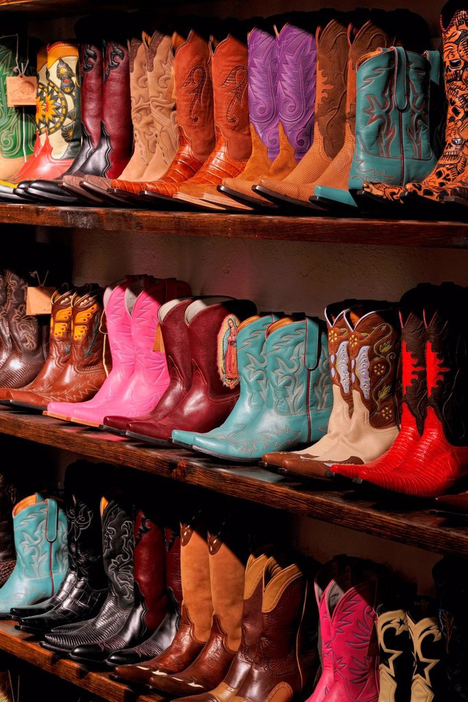 Western boots for sale in a shop_ ´Boots Boogie´, Santa Fe, New Mexico, USA : Stock Photo