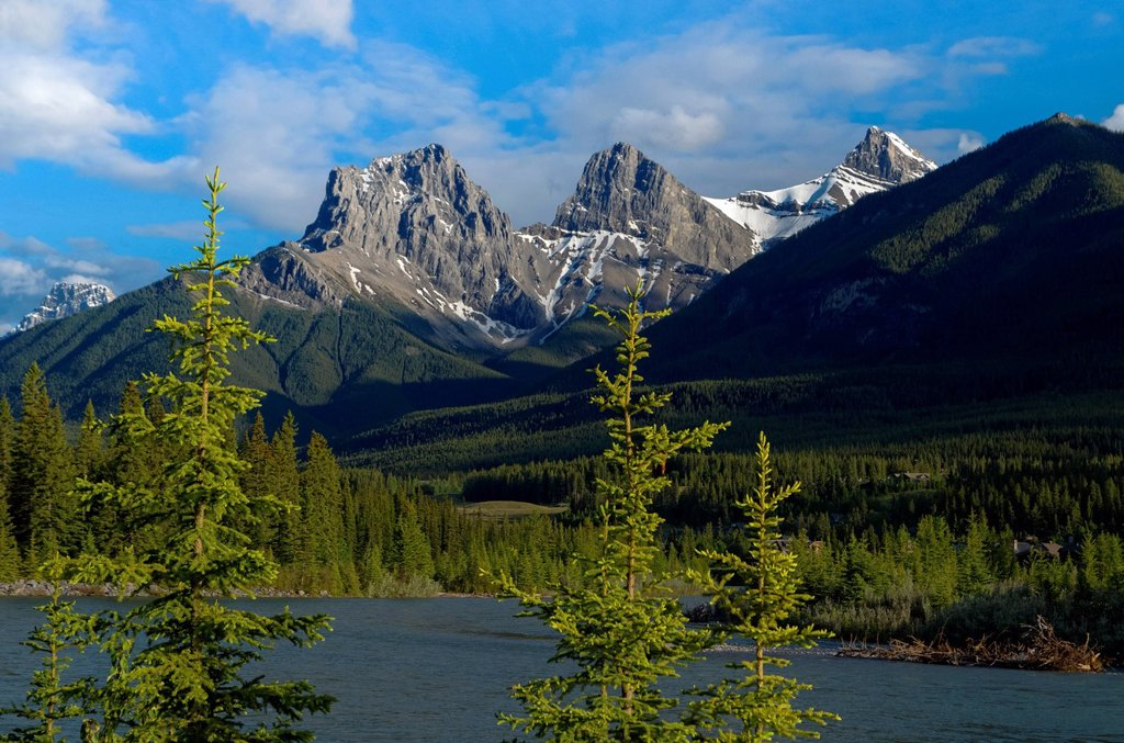 Stock Photo: 1990-65215 The Three Sisters, mountain peaks. The Bow River, Canmore, Alberta, Canada