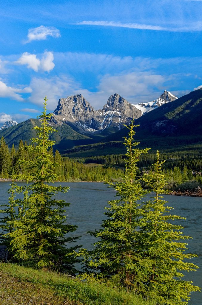 Stock Photo: 1990-65216 The Three Sisters, mountain peaks. The Bow River, Canmore, Alberta, Canada