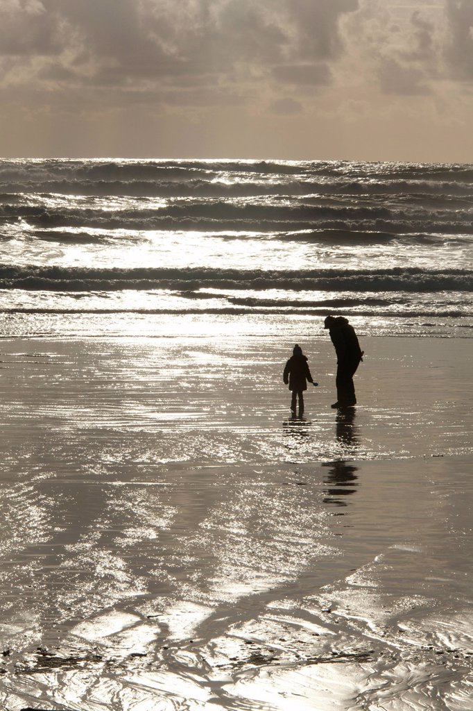 A father and daughter on Cox Bay beach near Tofino, British Columbia, Canada on Vancouver Island in Clayoquot Sound UNESCO Biosphere Reserve. : Stock Photo
