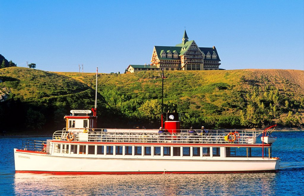 Stock Photo: 1990-6659 Tour boat in front of Prince of Wales Hotel in Waterton-Glacier International Peace Park, Alberta, Canada
