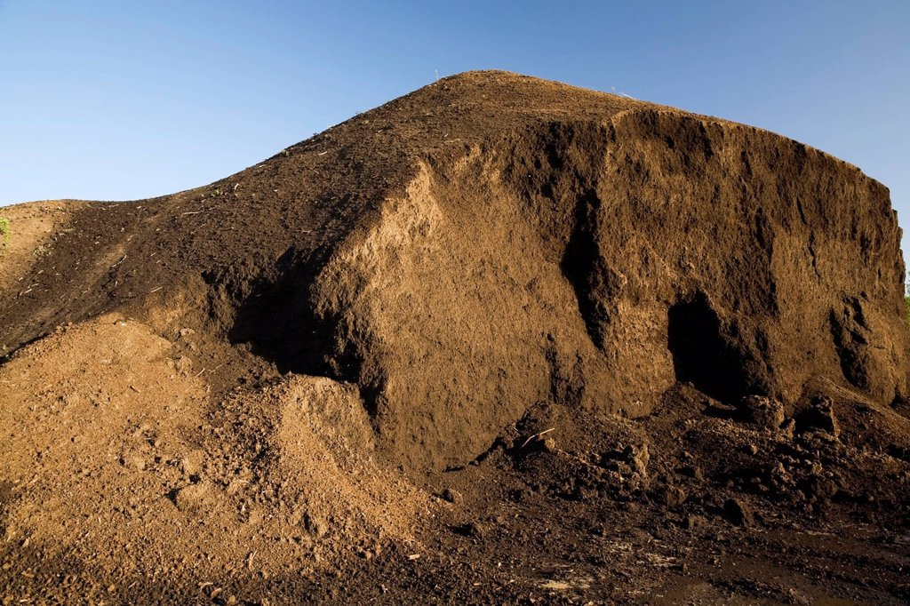 Stock Photo: 1990-67280 Mound of topsoil in a commercial sandpit, Quebec, Canada.