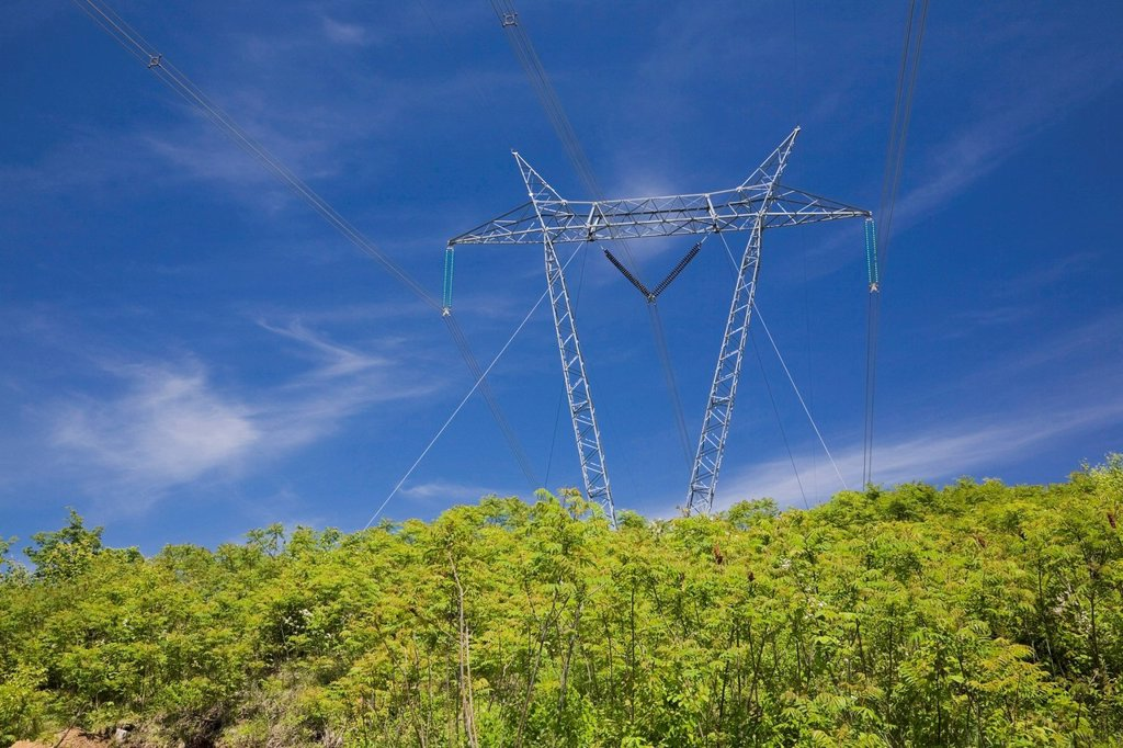 Electricity transmission tower in a field at springtime, Laurentians, Quebec, Canada. : Stock Photo