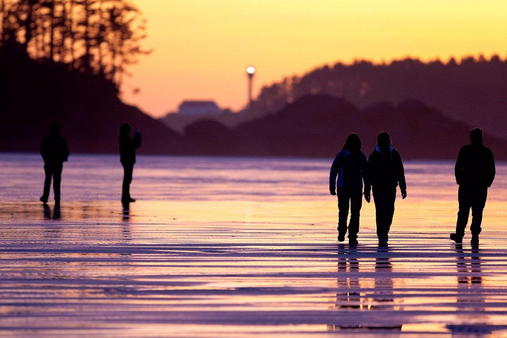 Stock Photo: 1990-70755 Evening strollers make their way along Chesterman beach. Long Beach, Tofino, Vancouver Island, British Columbia, Canada