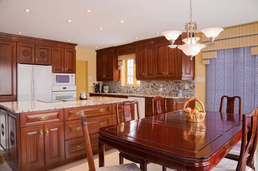 Stock Photo: 1990-70958 Classic style kitchen Chinese influenced with dining table in a modern cottage style residential home, Quebec, Canada