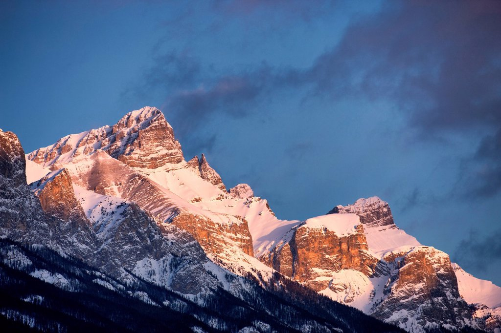 Sunrise on Three Sisters mountains above, Canmore, Alberta, Canada : Stock Photo