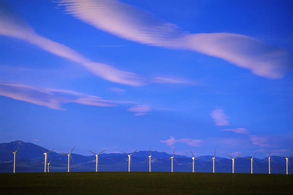 Stock Photo: 1990-7494 clouds, wind turbines and Rocky Mountains, Pincher Creek, Alberta, Canada