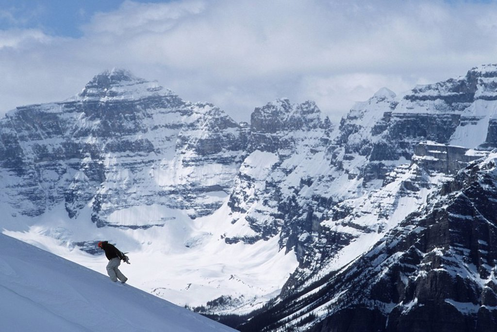 A Snowboarder boot packing up a run at Lake Louise Resort, Rocky Mountains, Alberta, Canada : Stock Photo