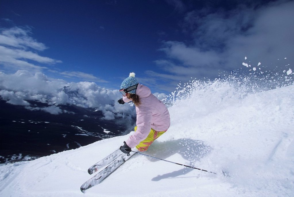 A female skier making turns at Lake Louise Resort, Rocky Mountains, Banff National Park, Alberta, Canada : Stock Photo