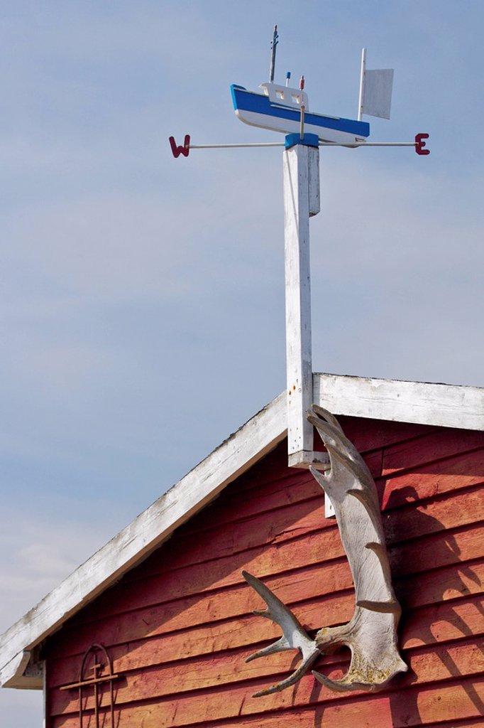 Weathervane atop a fishing stage in Conche Harbour, Conche, French Shore, Great Northern Peninsula, Viking Trail, Newfoundland & Labrador, Canada : Stock Photo