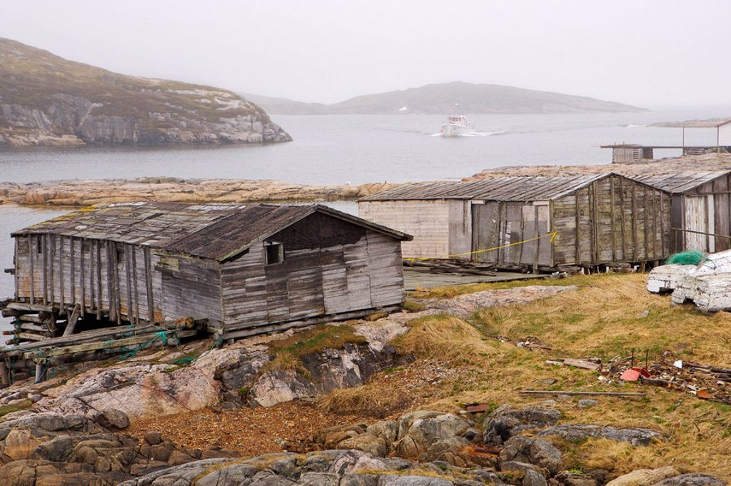 Old fishing stages along the shore at Battle Harbour, Battle Island at the entrance to the St Lewis Inlet, Viking Trail, Southern Labrador, Newfoundland & Labrador, Canada : Stock Photo