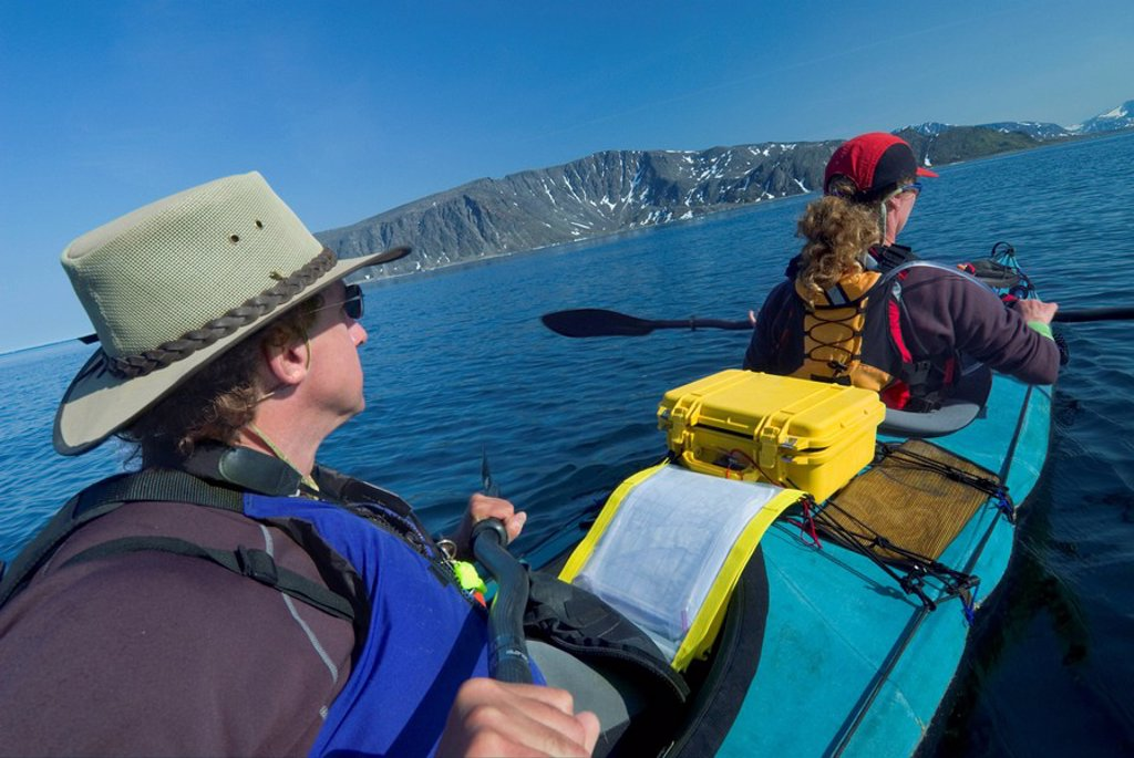 Kayaking in Ramah Bay with Torngat Mountains in the distance, Labrador, Newfoundland and Labrador, Canada : Stock Photo