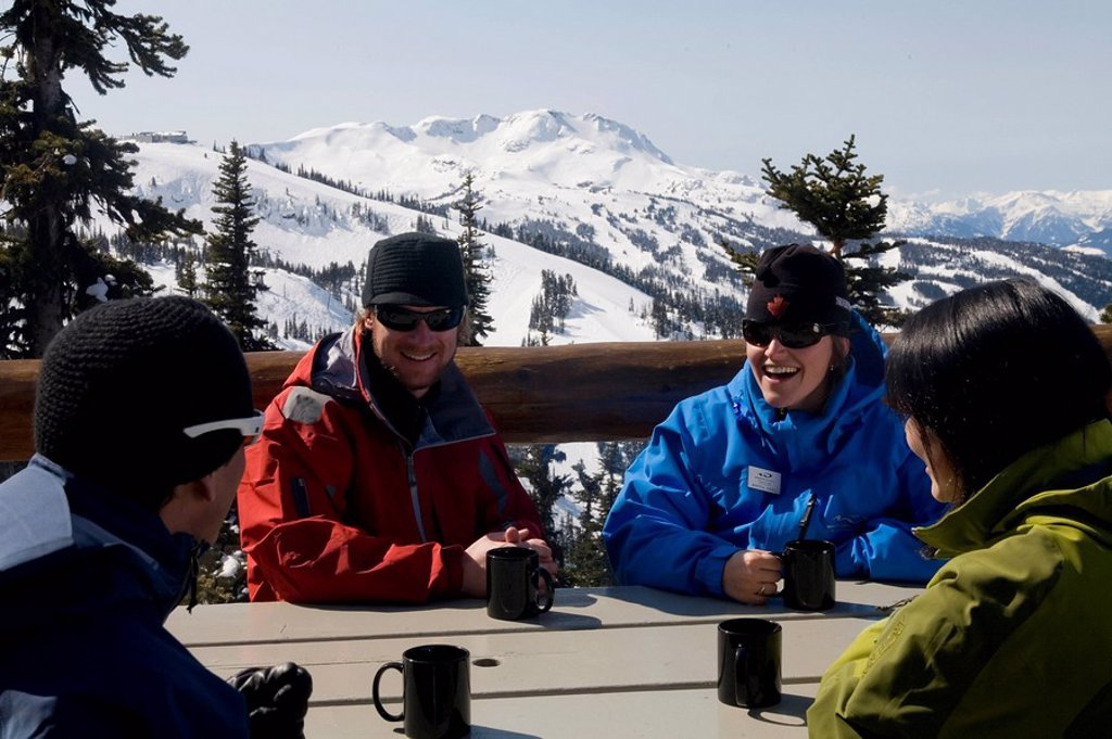 a group of skiers relaxing between runs, Whistler, British Columbia, Canada : Stock Photo