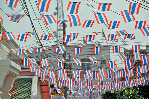 Thai flags hanging at an alley, Wat Arun, Bangkok, Thailand : Stock Photo