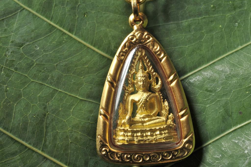Buddhist amulet on a leaf, Bangkok, Thailand : Stock Photo