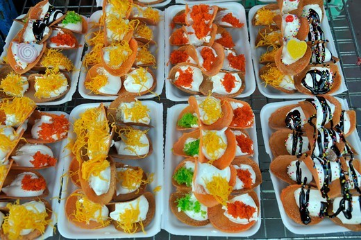 Thailand, Khon kaen, Crispy Thai pancakes, Khanom Buang with coconut cream filling and various toppings such as shredded coconut, eggs yolk, spring onions, chocolate and sugar sprinkles : Stock Photo
